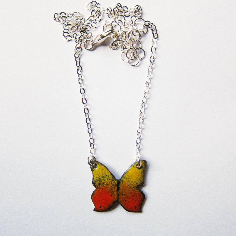 Tiny butterfly necklace in enamel