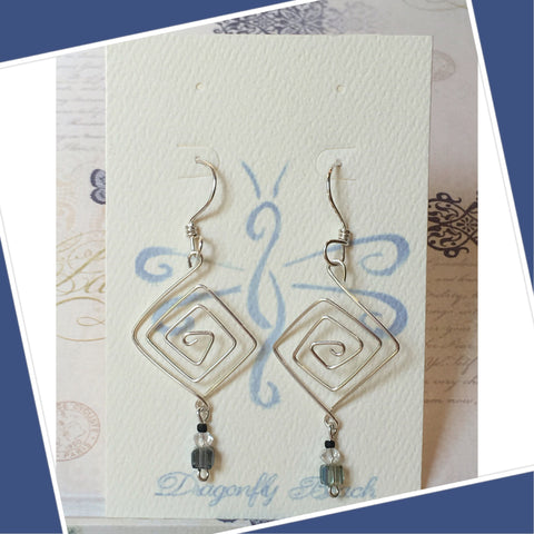 Hand bent sterling silver diamond earrings