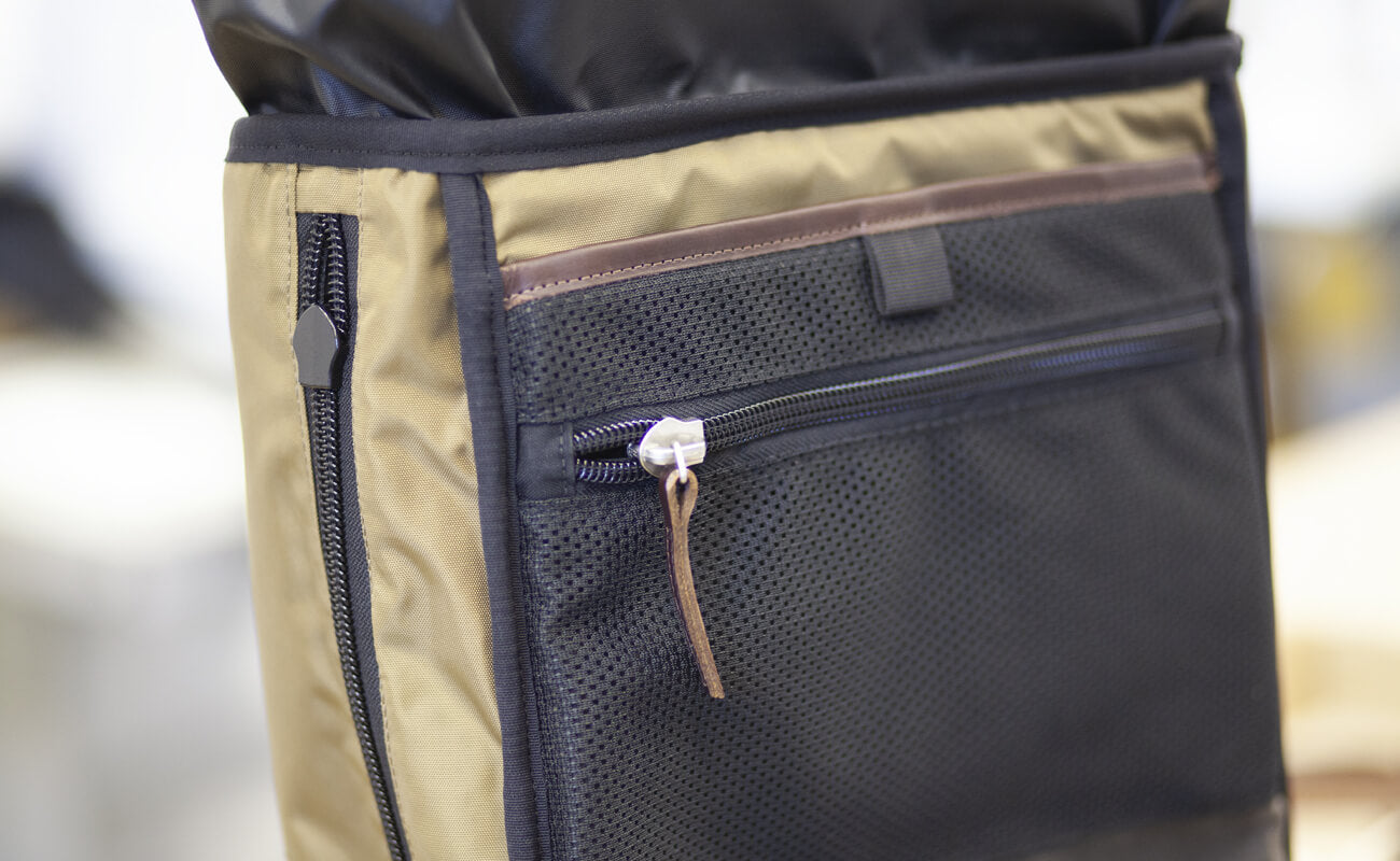 Checking the internal zipped pocket and side zips before turning the backpack