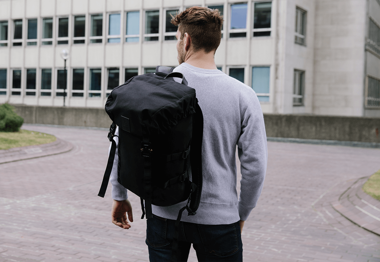 Amhara waxed canvas and leather backpack for longer trips away, made with a 15 inch laptop sleeve and weatherproof fabrics