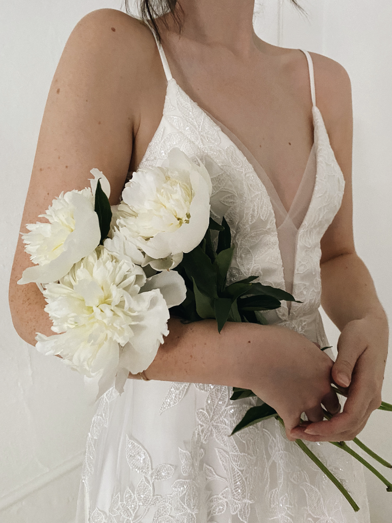 bride holding sustainable bouquet