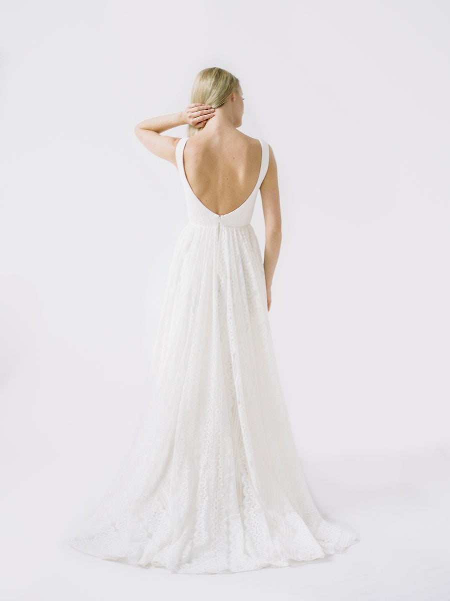 a boho wedding gown with a deep low back and allover lace