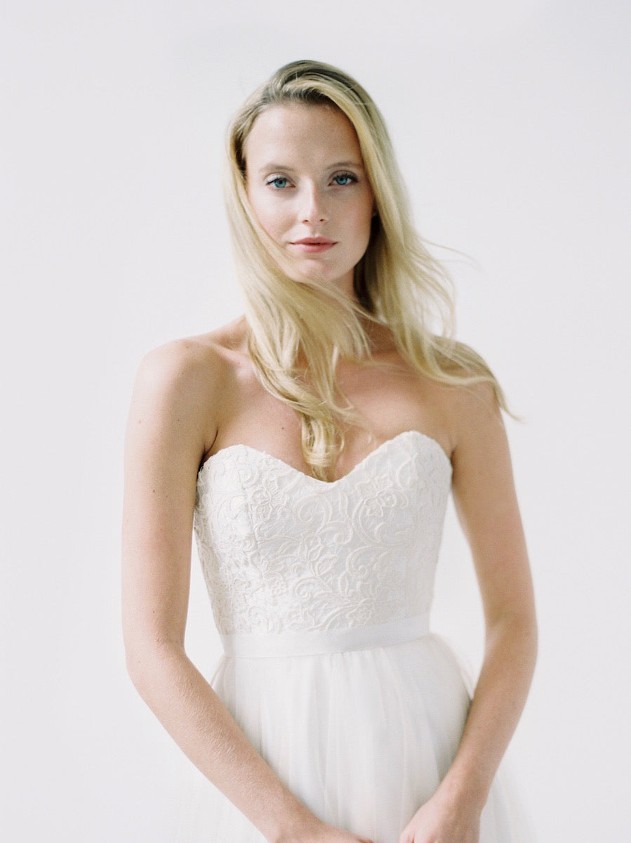 A strapless sweetheart gown with unique beading and a lace up back