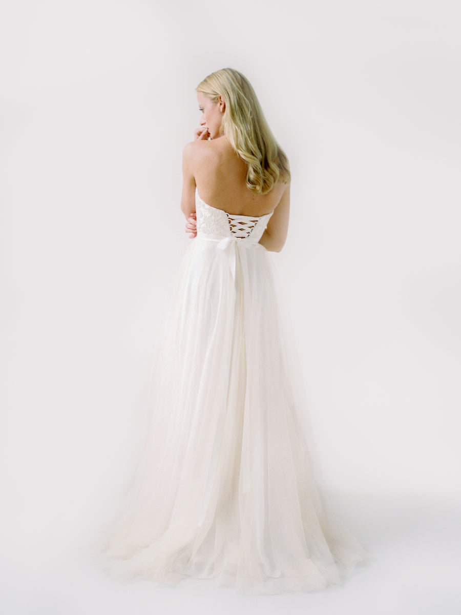 A unique wedding gown with corset ties, a sweetheart bodice, and a tulle skirt