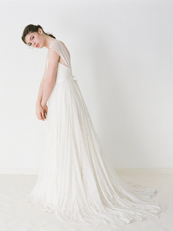 A lace wedding gown with cap sleeves and chiffon.