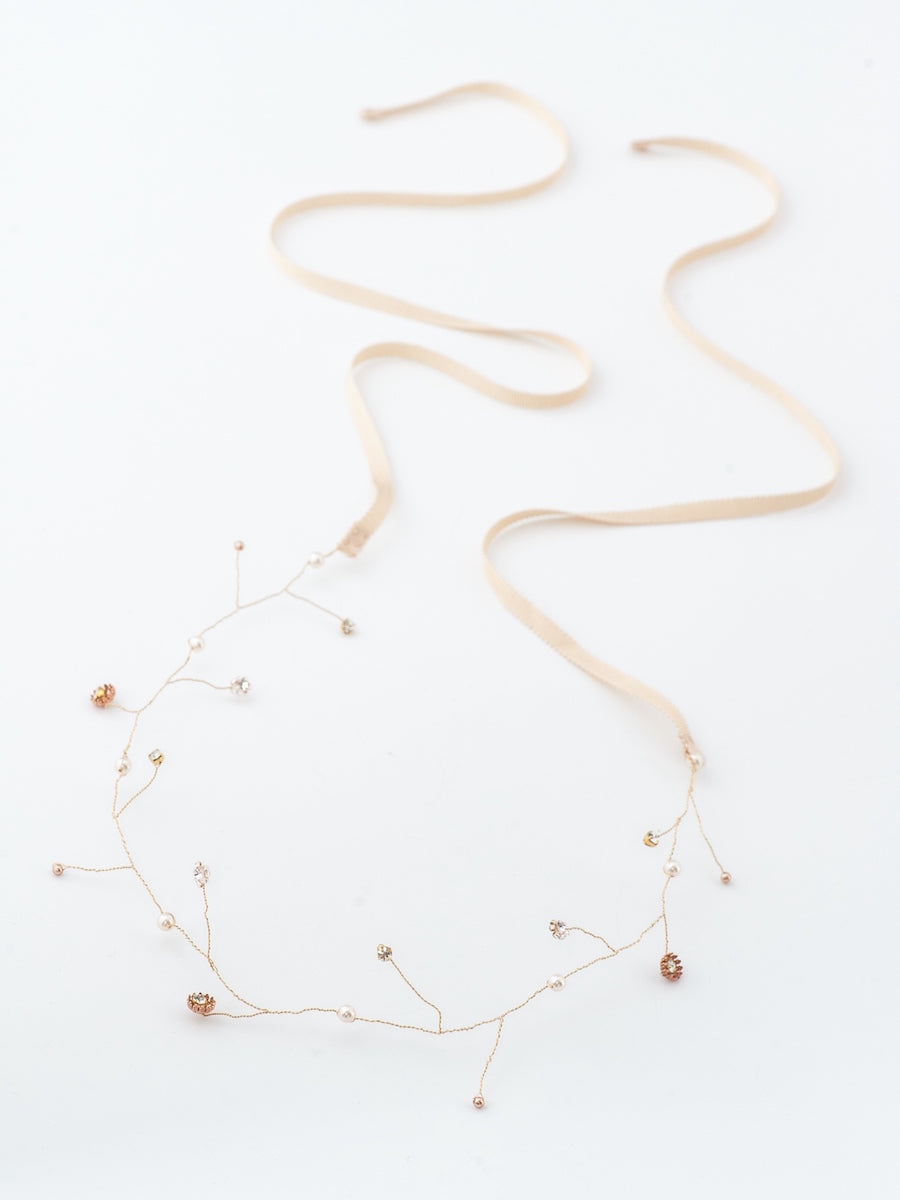 A gold hand-wired hair vine made with Swarovski crystals, pearls and glass beads.
