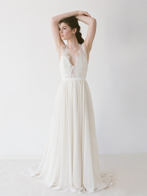 A chiffon wedding gown with lace straps