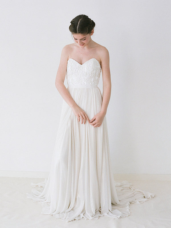 An ivory sequinned wedding gown with shimmer godets within a chiffon skirt.