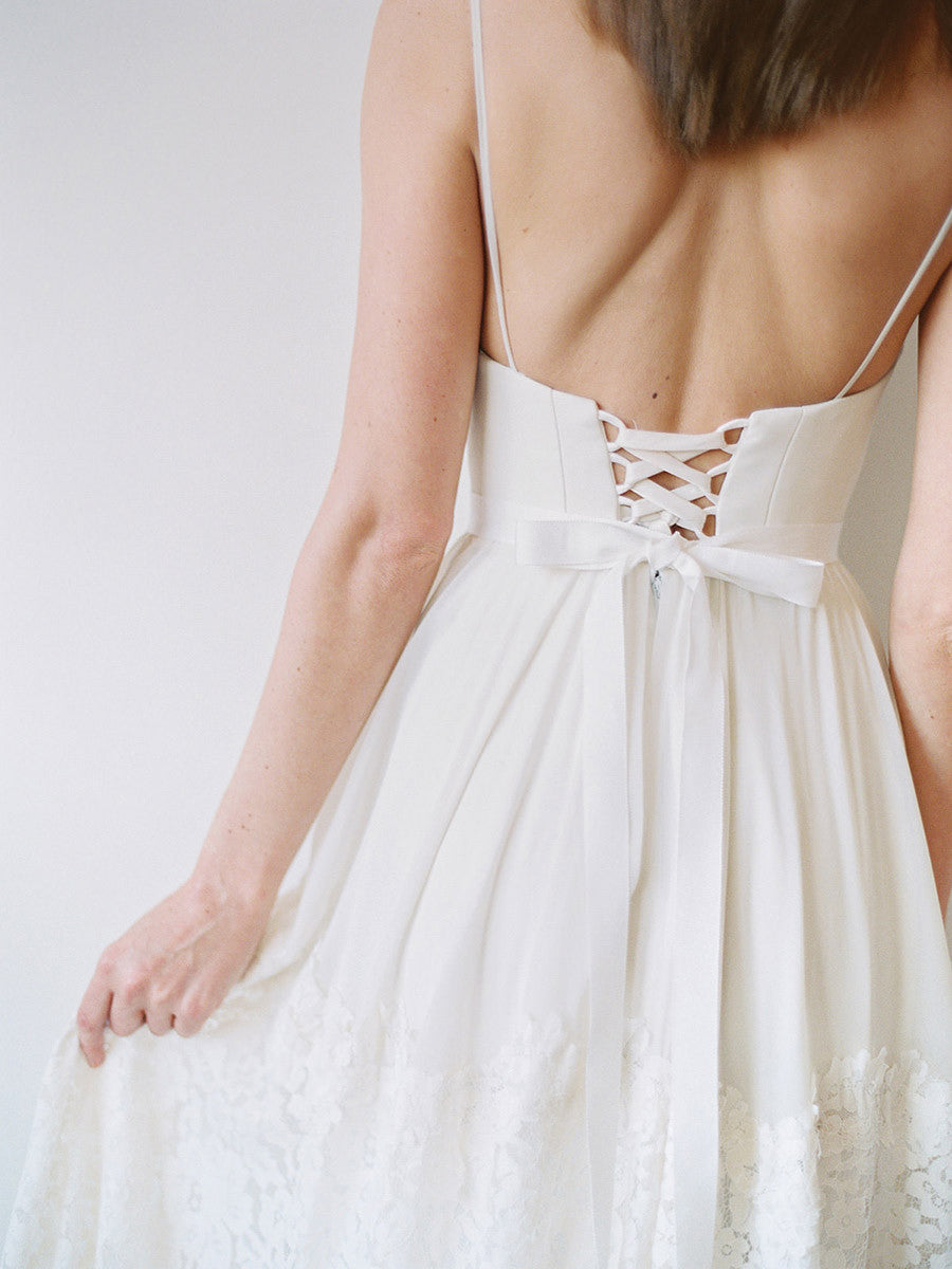 A spaghetti strap wedding gown with a corset back