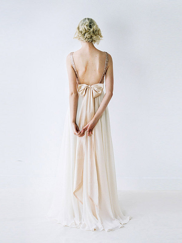A rose gown sequinned, backless wedding gown