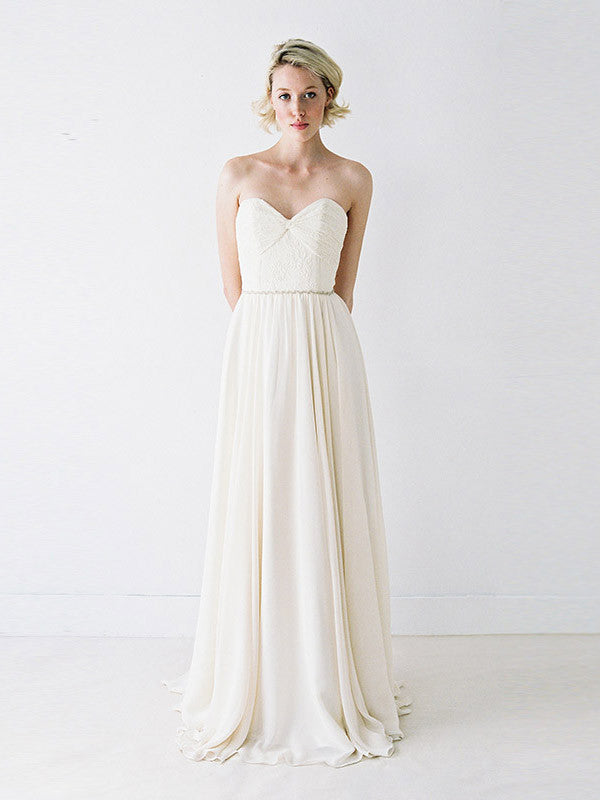 A ruched lace and chiffon wedding gown