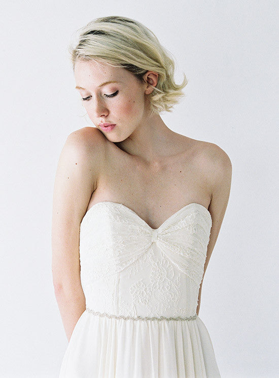 A lace and chiffon wedding gown.