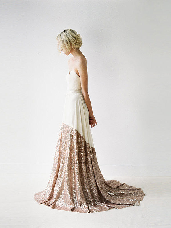 A modern wedding gown with a rose gold sequinned skirt