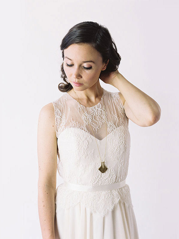 Sweetheart neckline wedding gown with lace top.