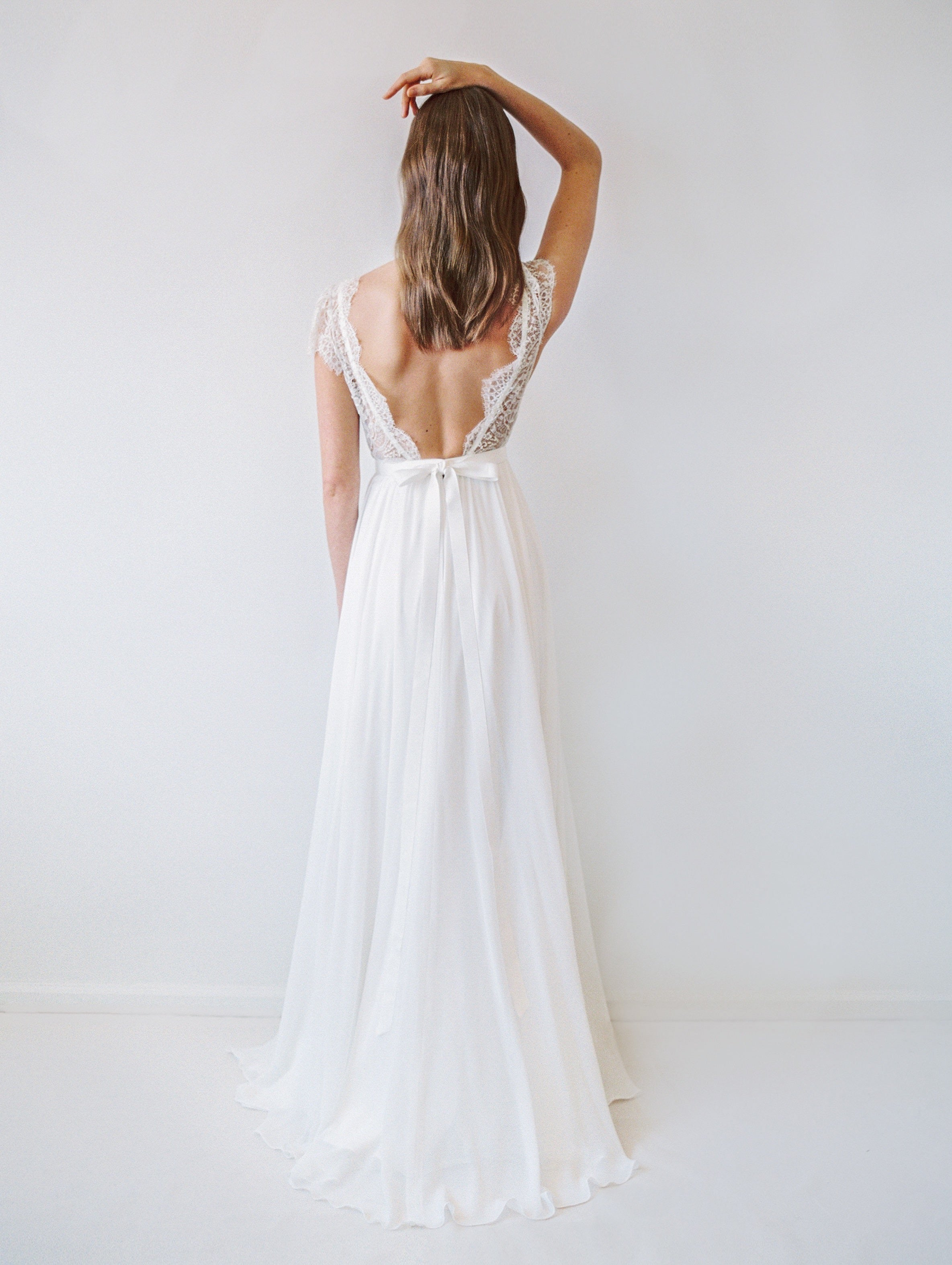 Flowy beach wedding dress with beaded cap sleeves and an open back