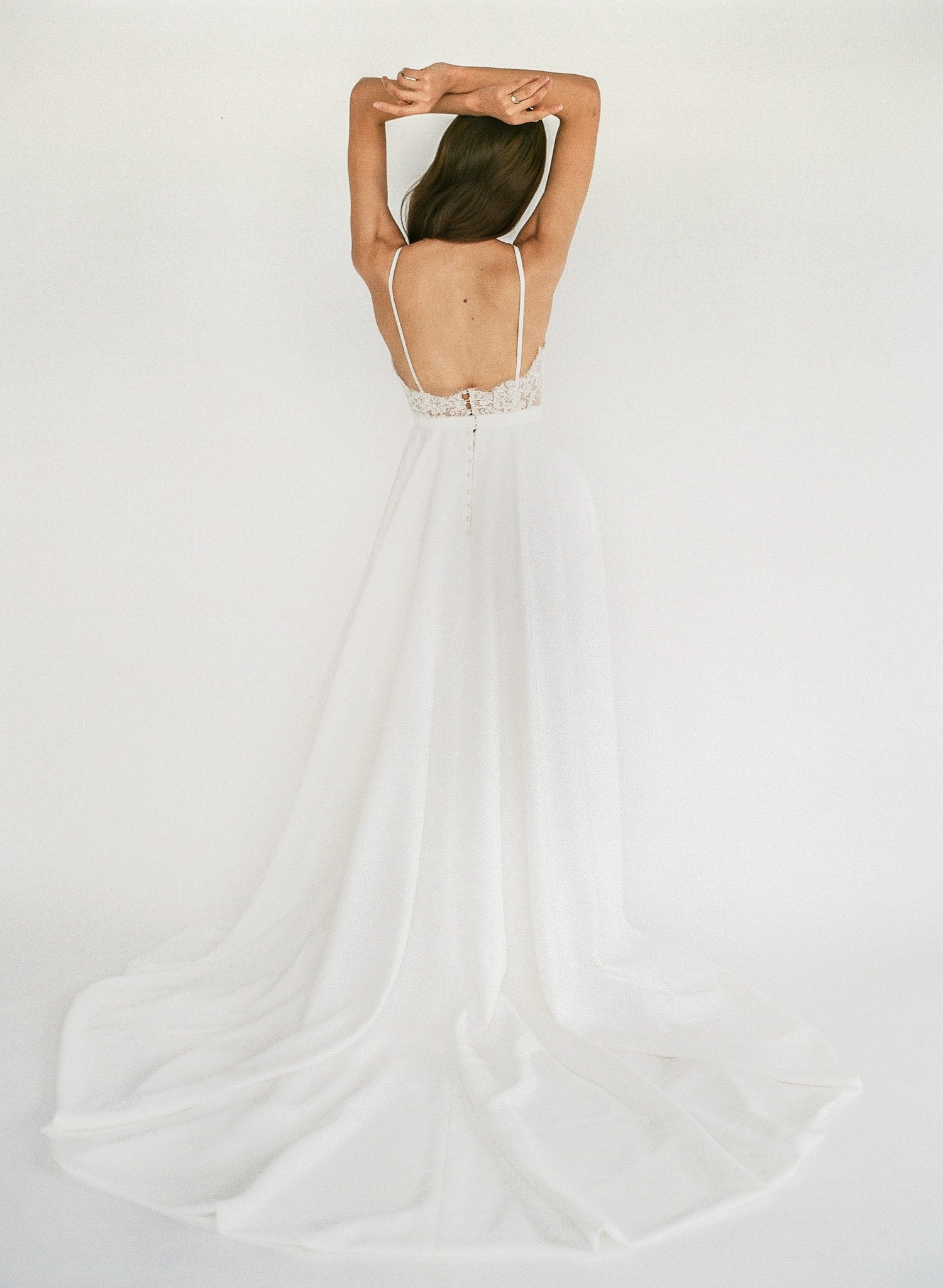 Ethical handmade romantic wedding dress with beaded lace, a button up back, and a crepe skirt with hidden pockets