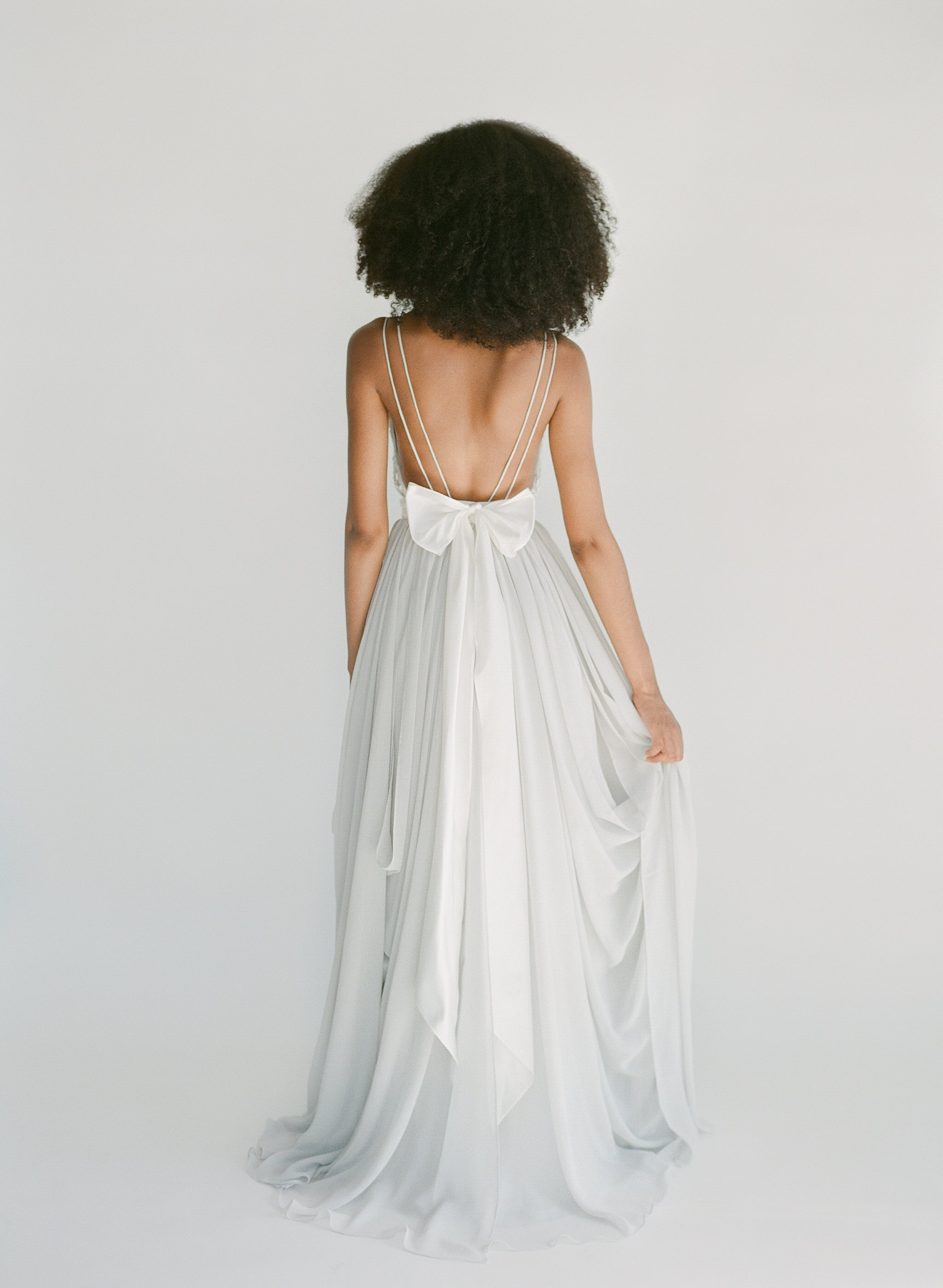 Ethically made silver beaded wedding dress with double straps and an open back