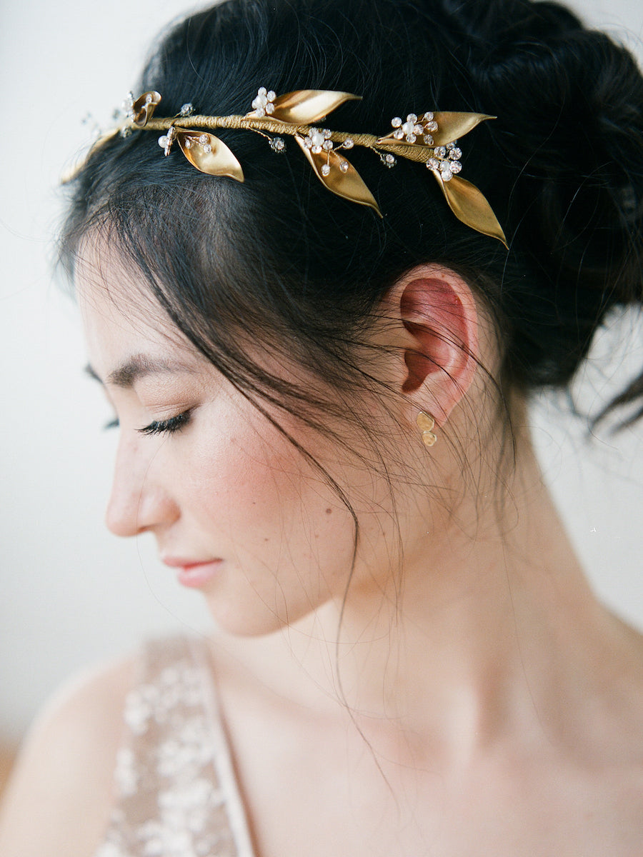A brass leaf headpiece with crystals and pearl flowers