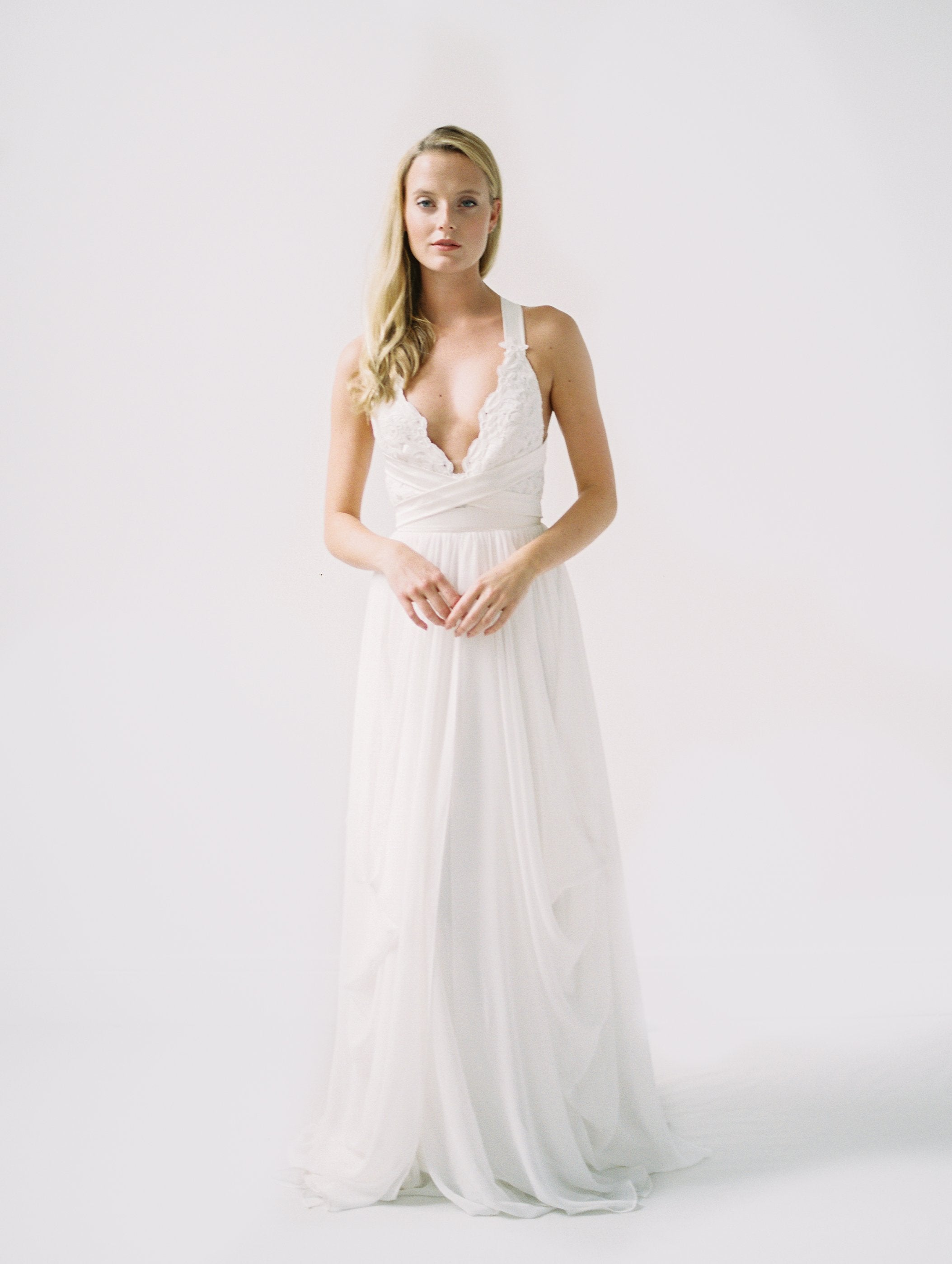 Wedding dress for beach wedding with multiway straps, white lace, and a long chiffon train