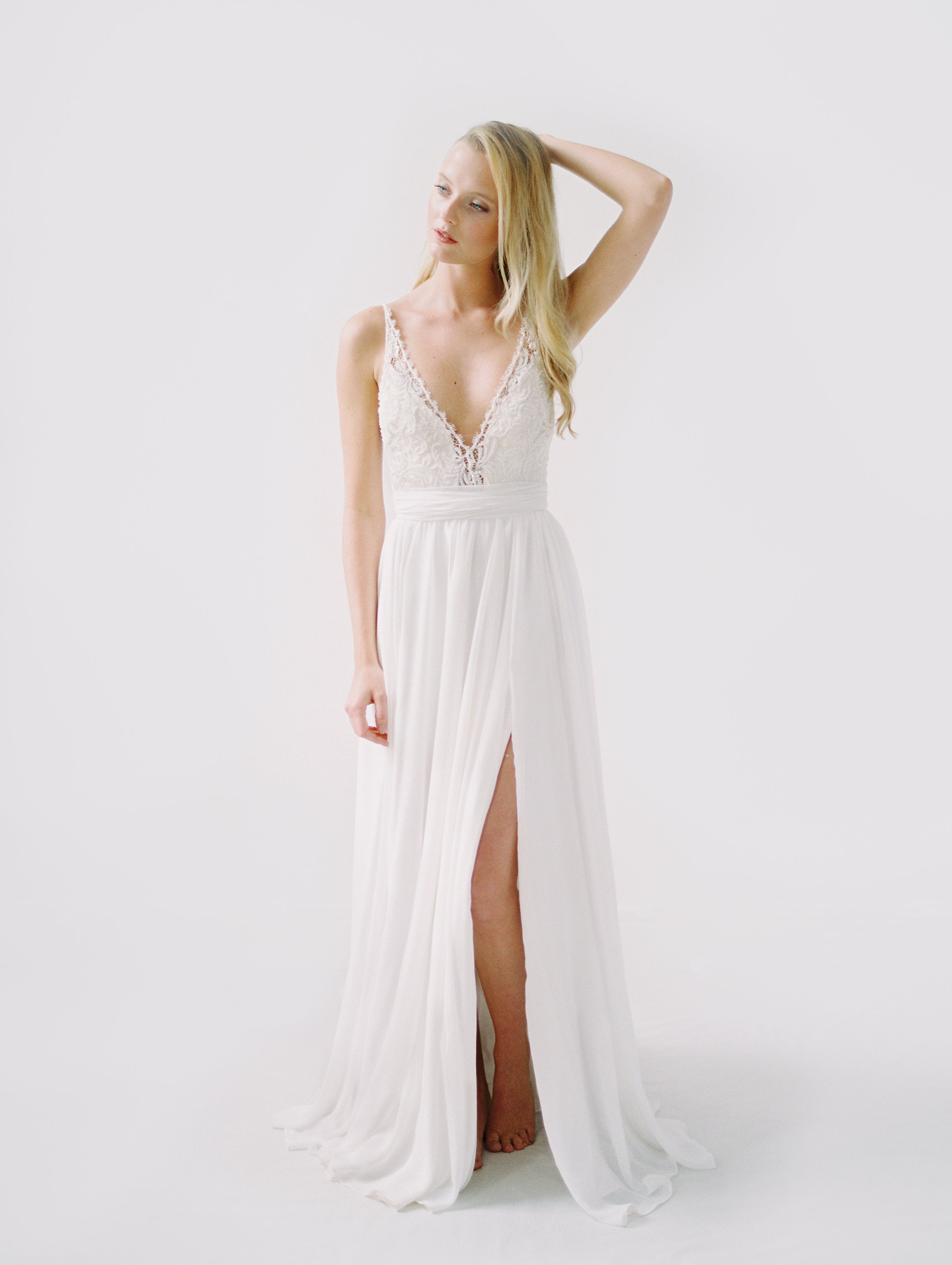 Lightweight beach wedding dress with a train and side slit, and a beaded low back top
