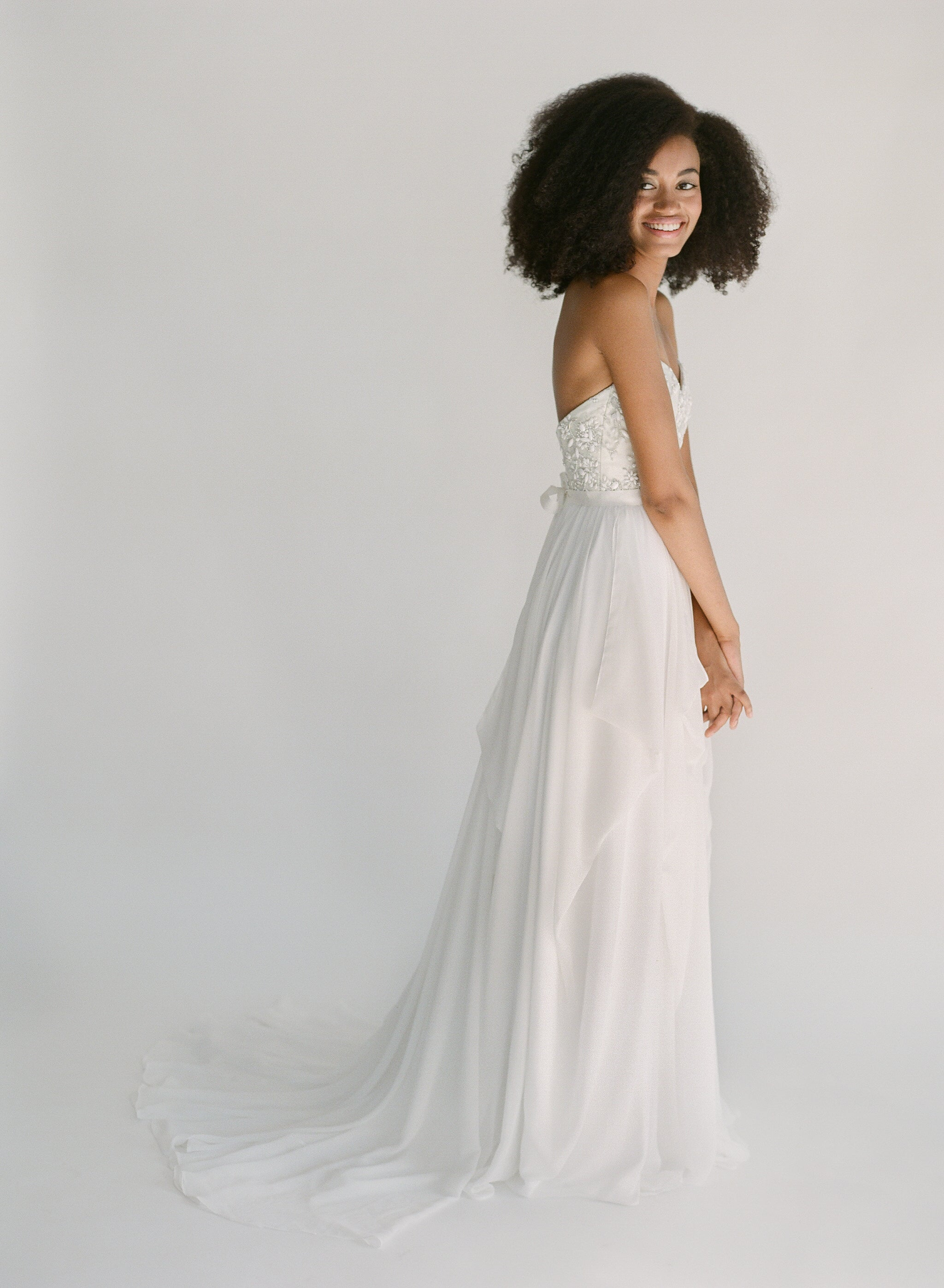 Strapless sweetheart wedding dress with silver beading, a corset back tie, and a lightweight chiffon skirt