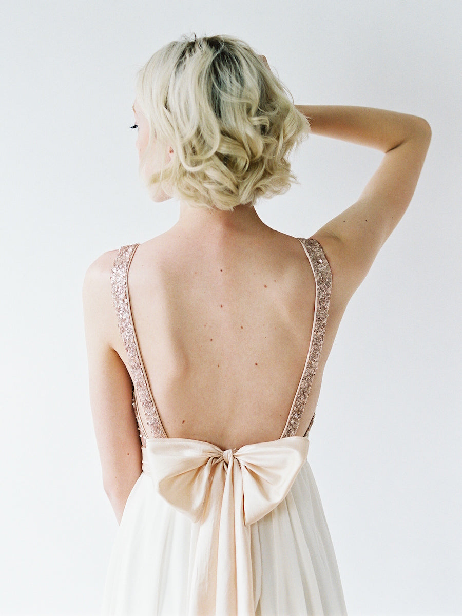 Backless wedding gown with a rose gold sequin bodice