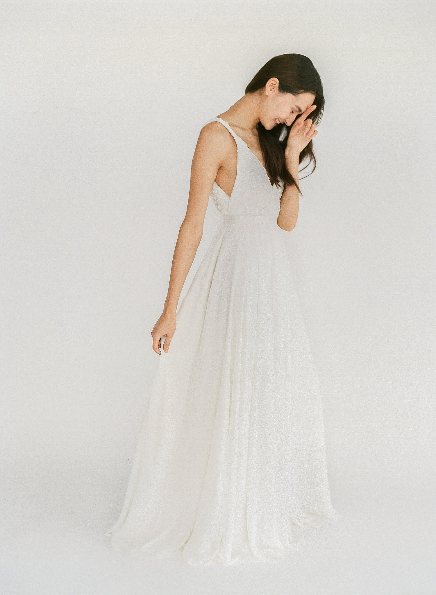 Ethical handmade wedding gown with delicate beaded lace, a flowy chiffon skirt, and an open back