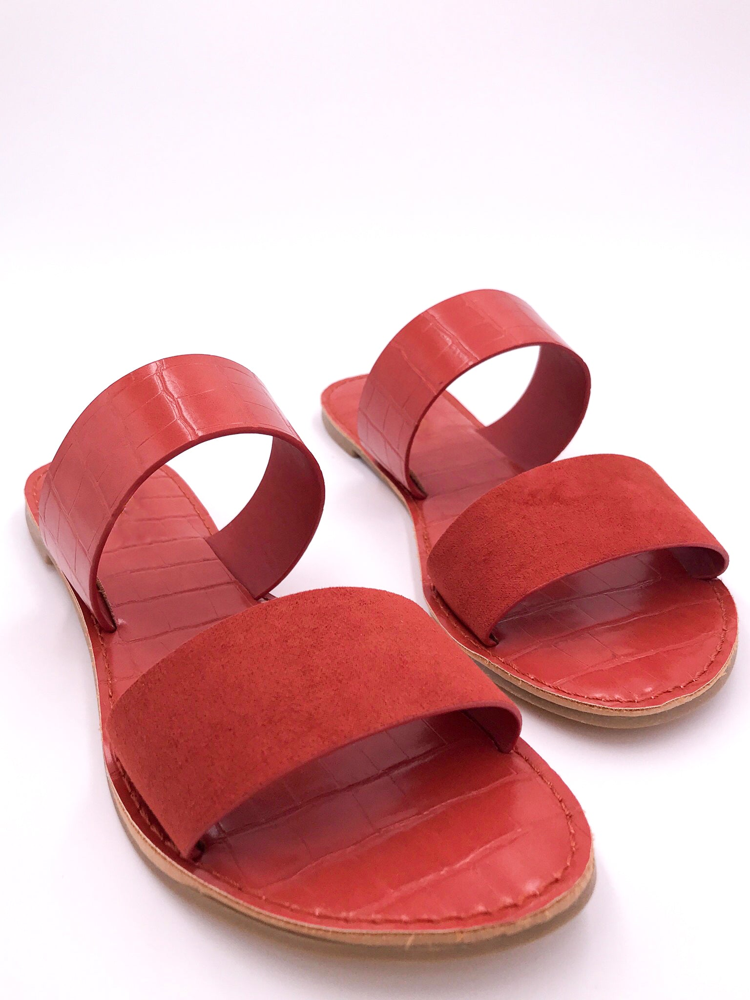 red slip on sandals , red suede, red leather