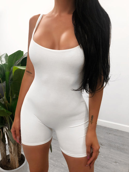 white spaghetti strap full romper, shows full cleavage, romper ends mid thigh,