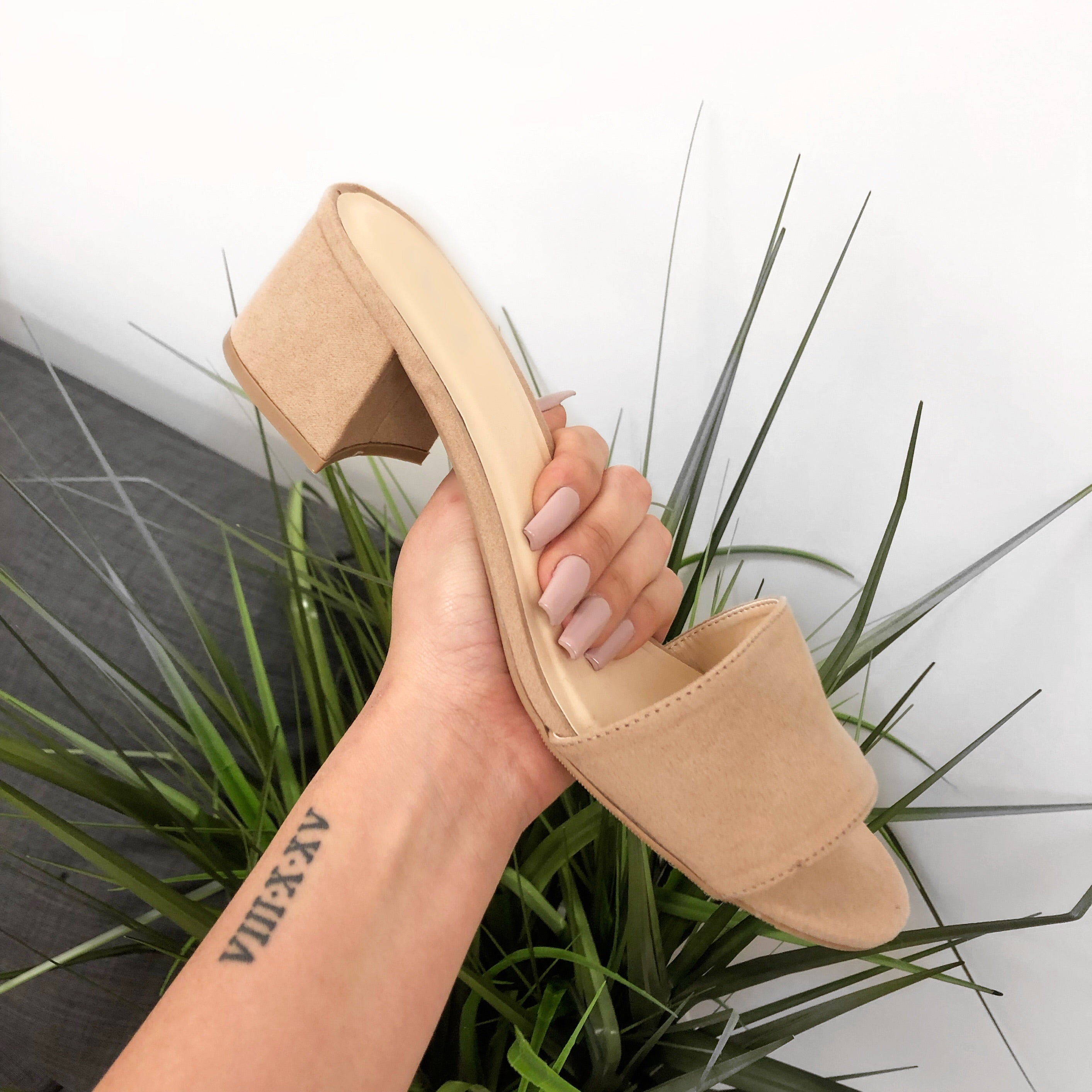 nude heel sandal. Heel is about 1.5 inches. Open toe sandal. Very comfortable.