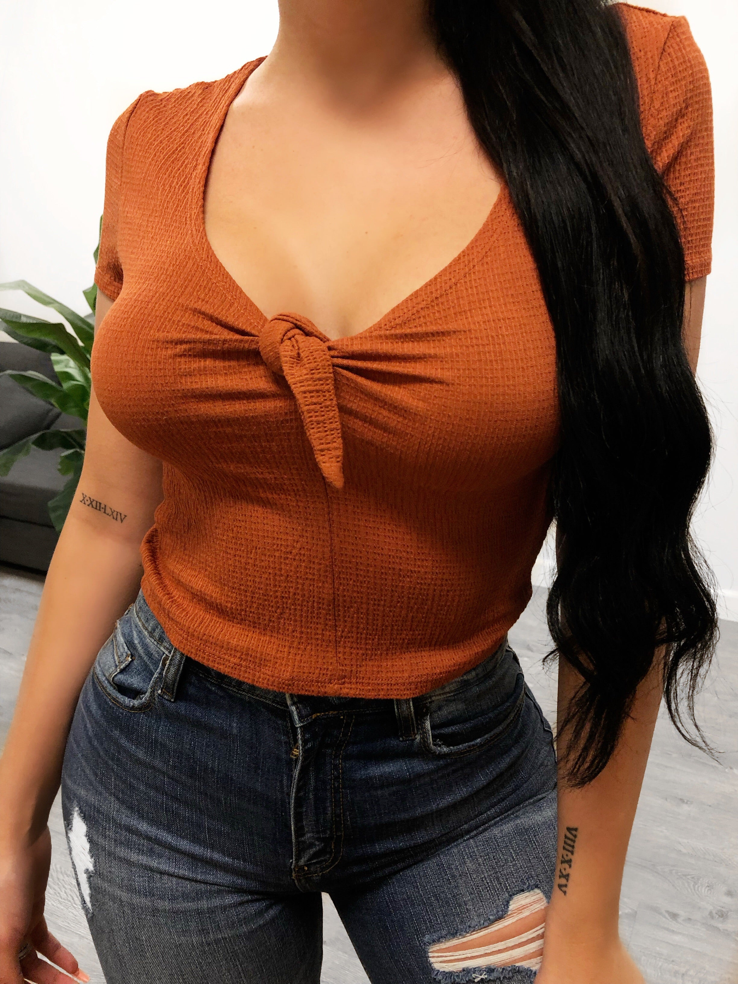 tight fitting t-shirt sleeves, tied up middle cleavage opening