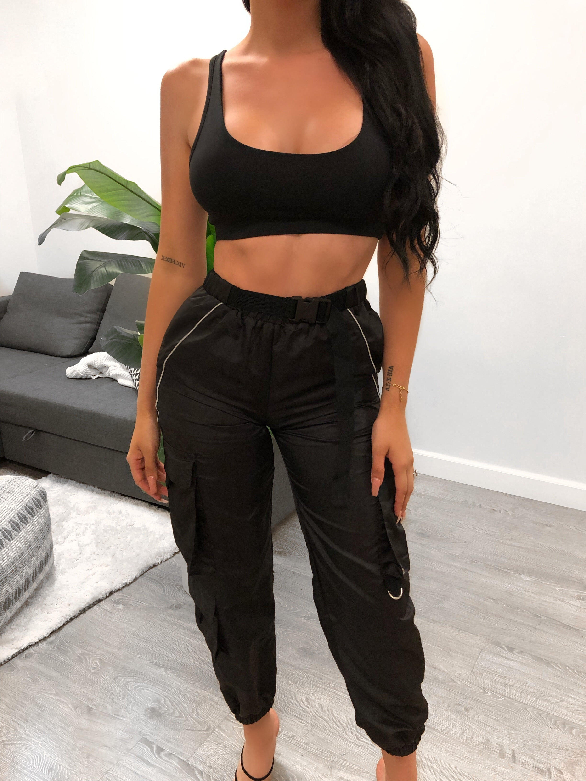 black joggers, high waist, silver outline, pockets