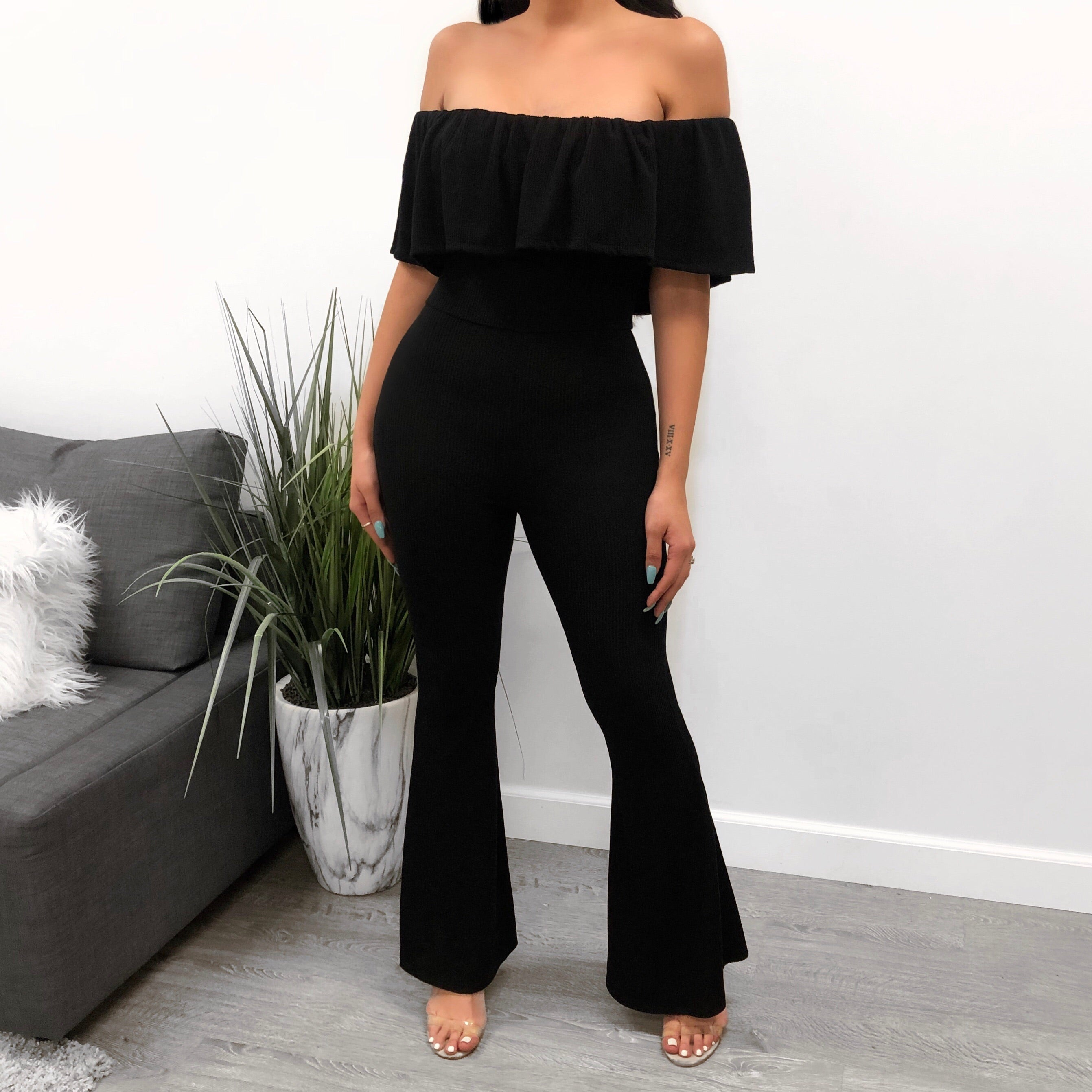 black jumpsuit with ruffled top. bottoms are bell bottoms. comes in 2 colors!