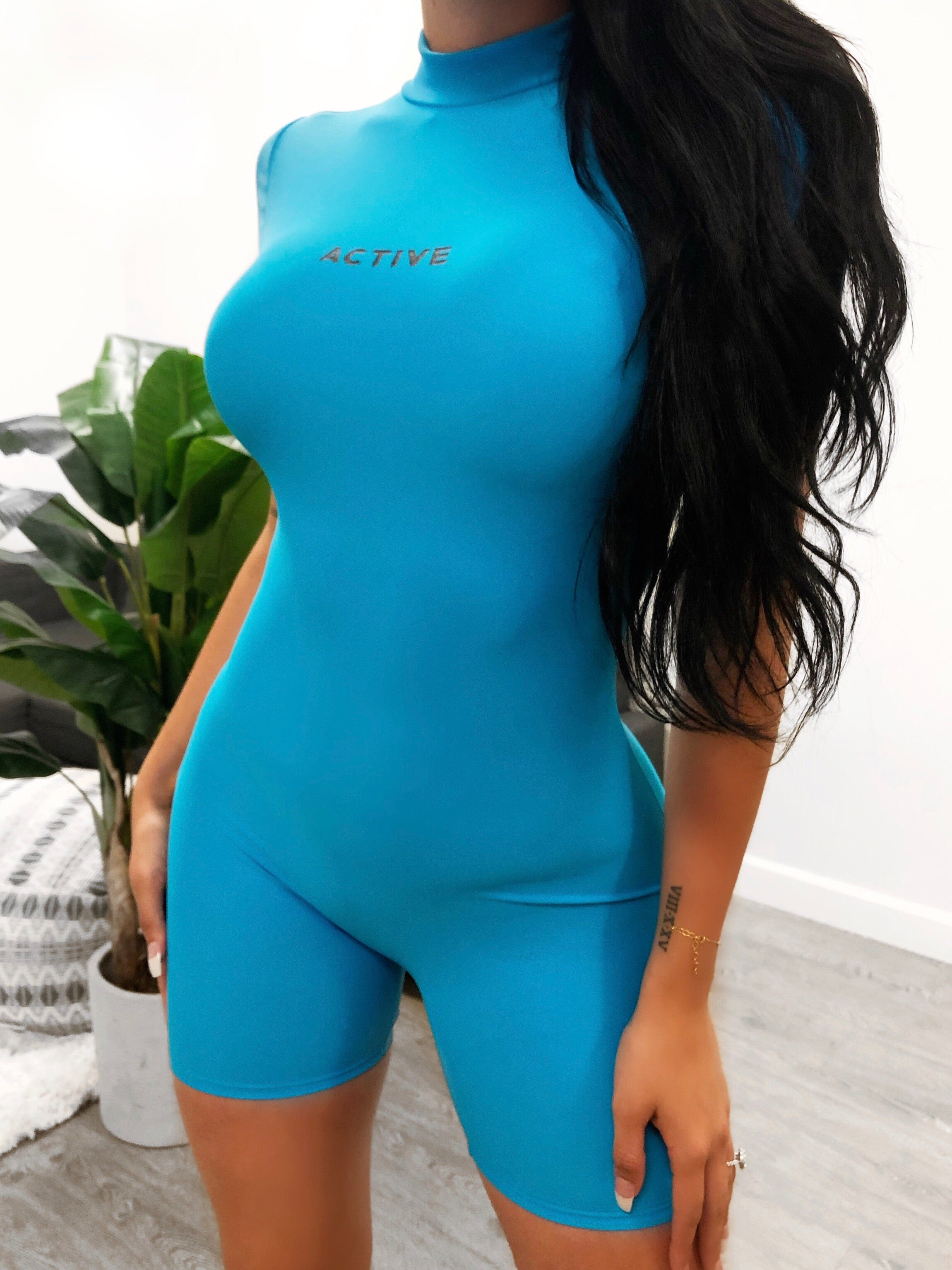 sports, romper has a turtleneck, tight fitting t-shirt sleeves, length is to mid thigh