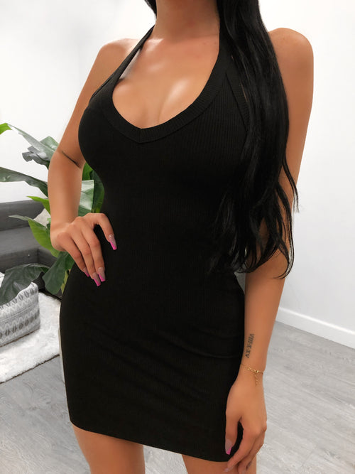 Black halter neck dress, shows medium cleavage,  dress length mid thigh, back is mid cut