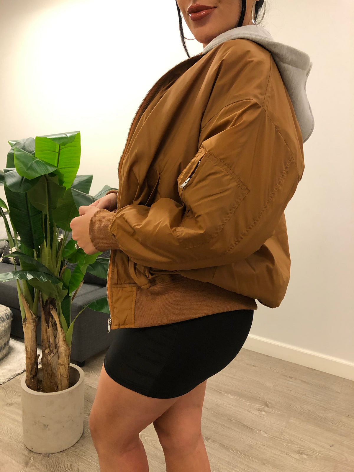 brown jacket, grey hoodie, silver zippers, oversized