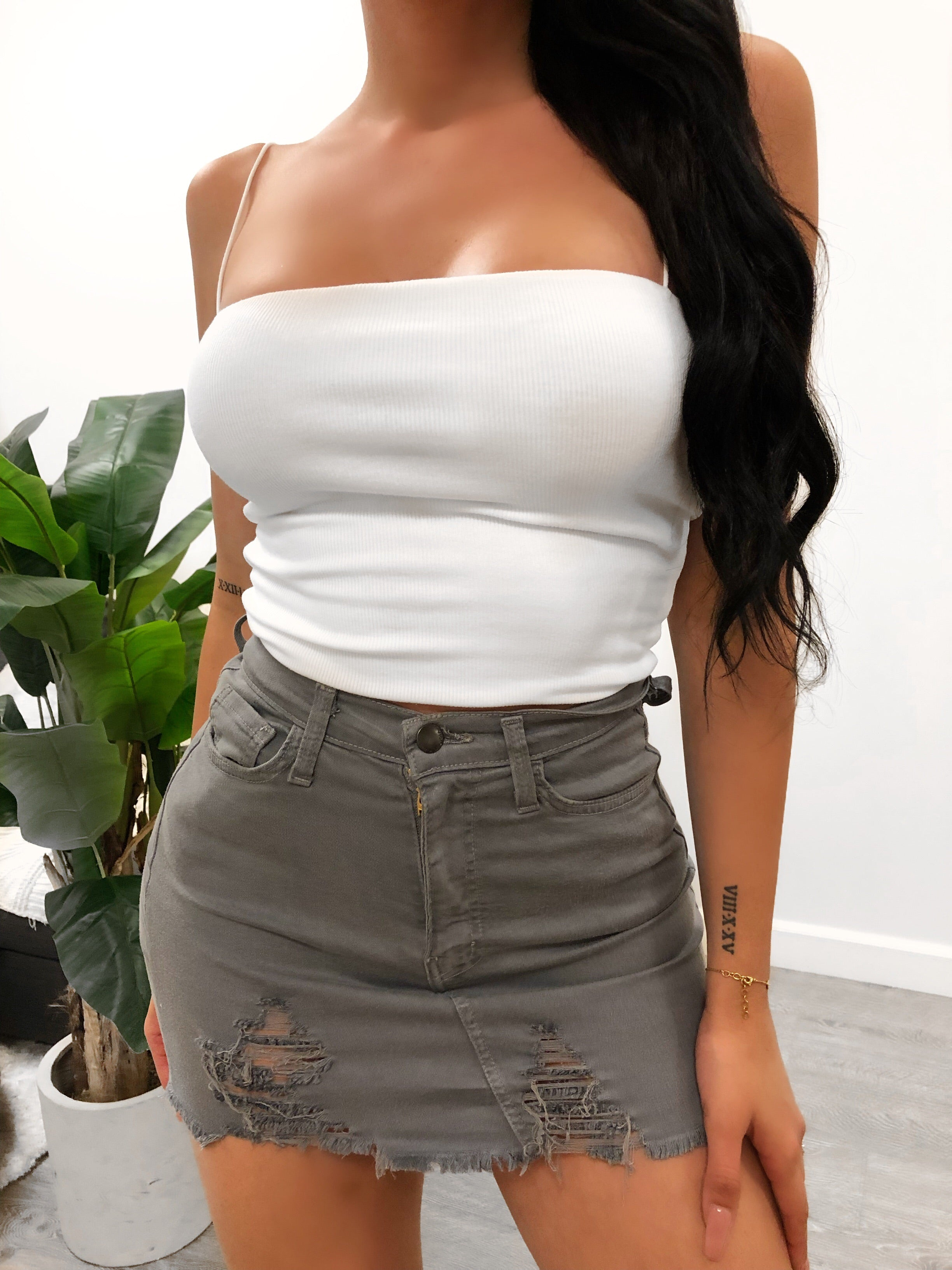 grey short skirt. distressed. high waisted. above mid thigh length.