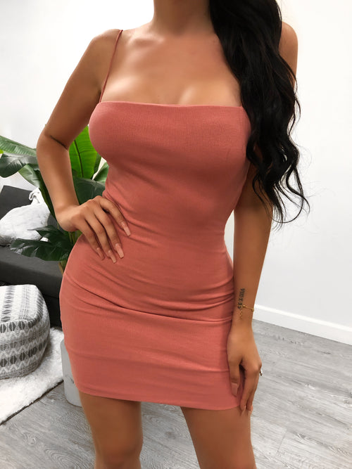 squared tank, spaghetti strap dress, tight fitting. length to mid thigh