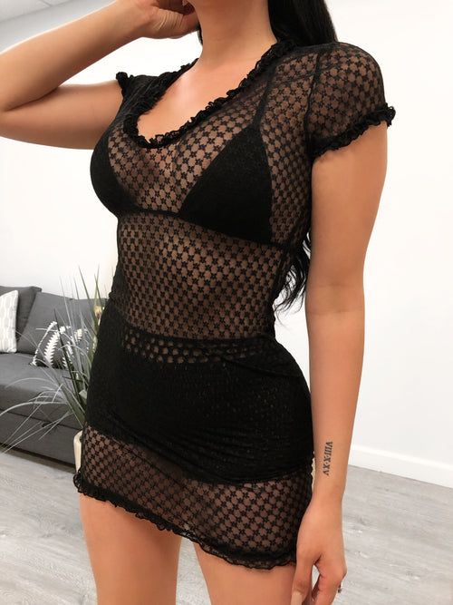 black mesh dress. round neckline. mid thigh length. short sleeves. can be worn as a cover.