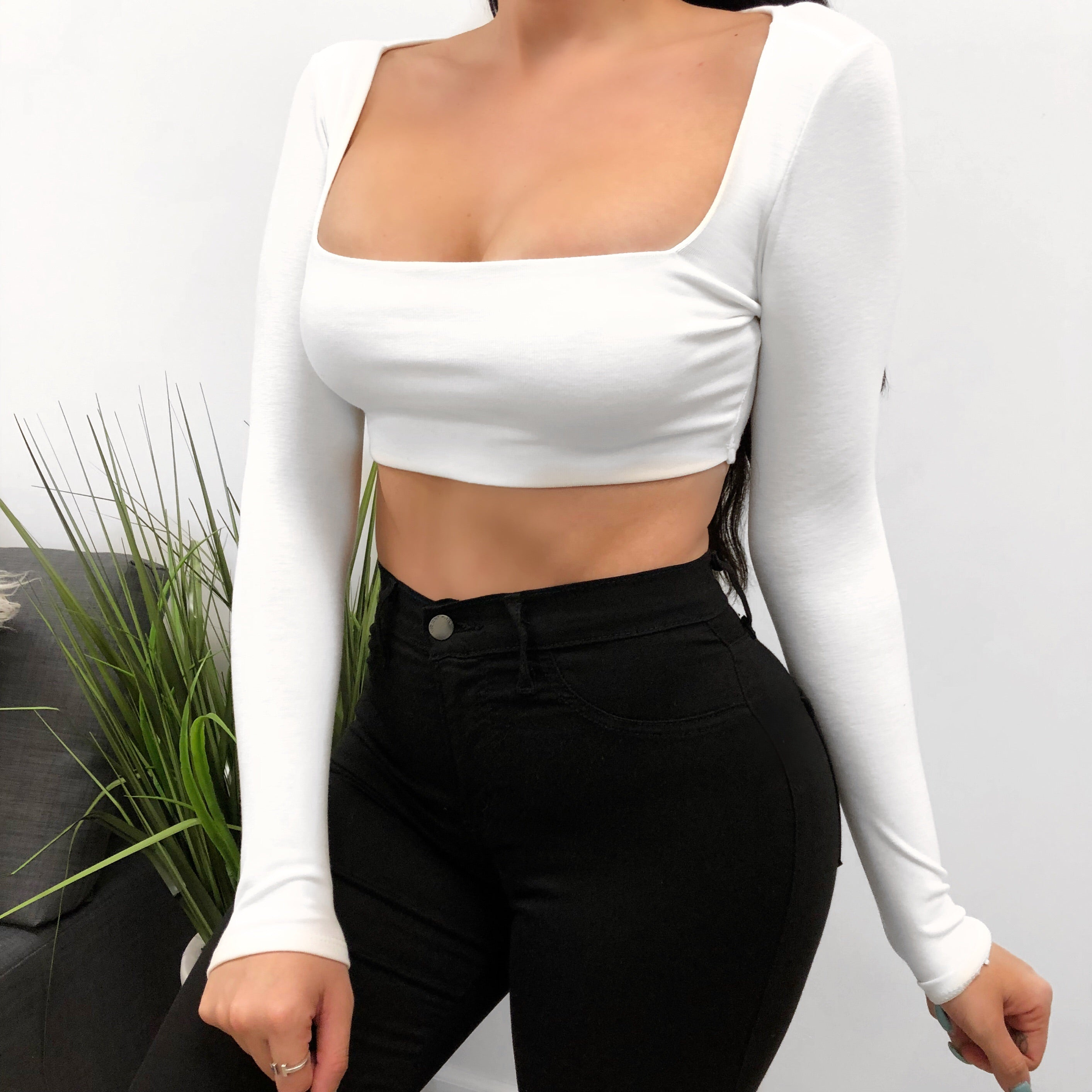 white long sleeve crop top, has square neckline, length ends to mid stomach
