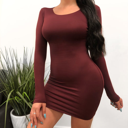 burgundy wide crew neck long sleeve dress. dress hugs the body and arms. dress length is to mid thigh.