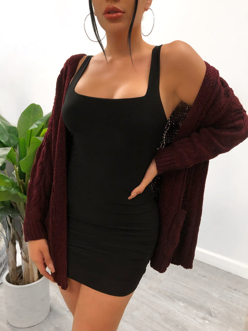 Burgundy woven cardigan. Long sleeves and mid-thigh length wth pockets.