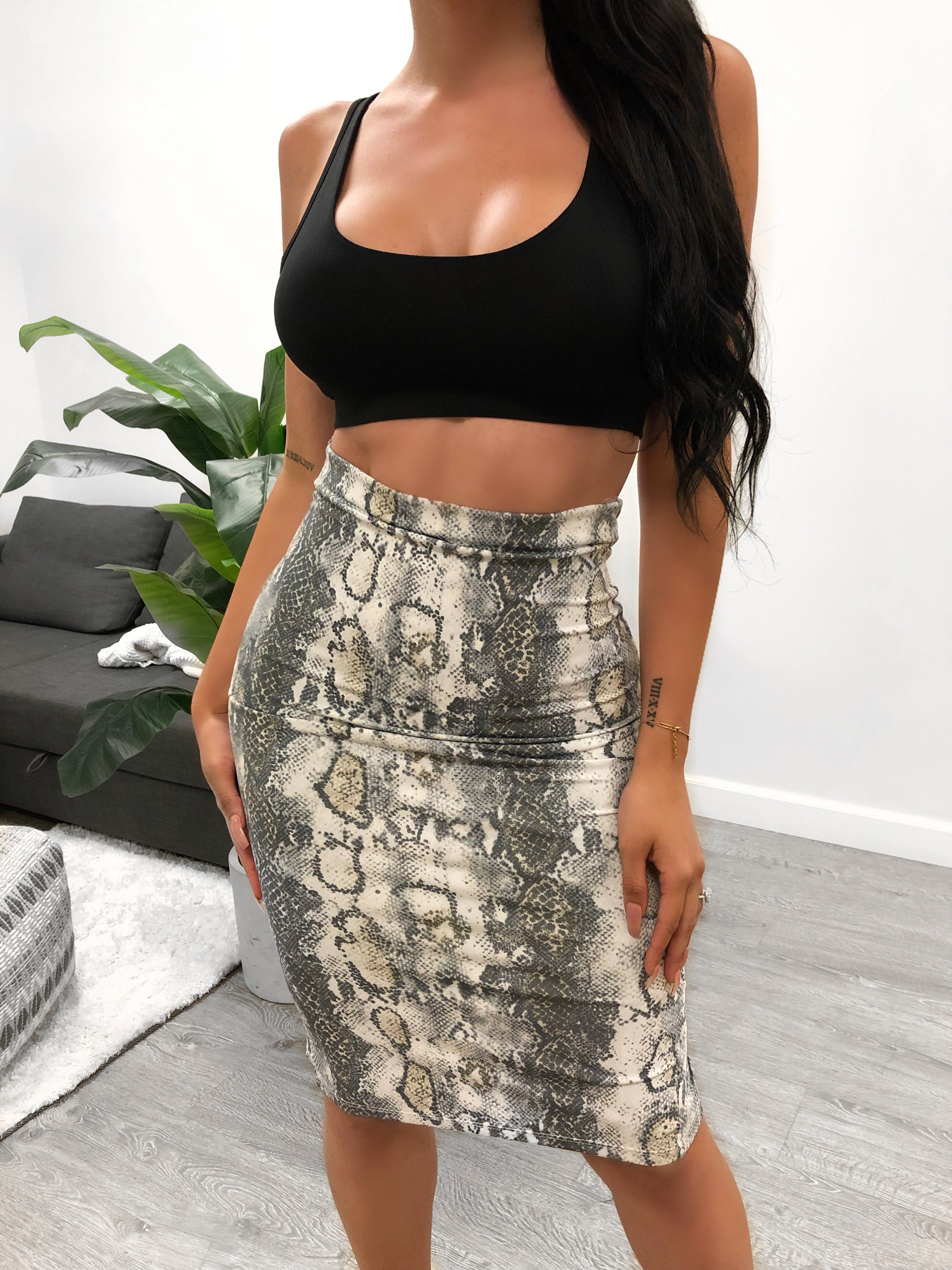 white snake print high waisted skirt, goes to the knees, has small slit in the black