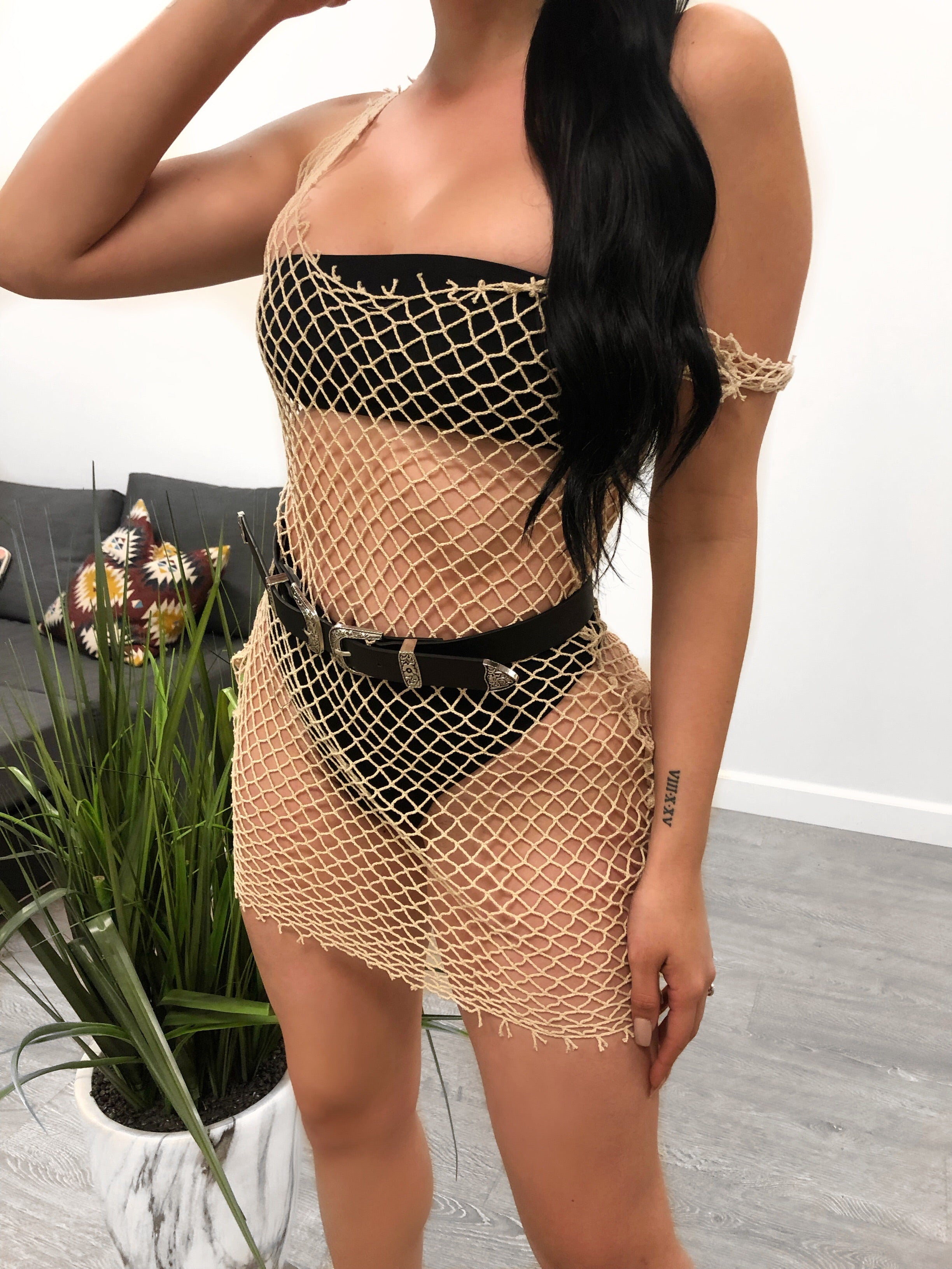 tan fishnet wide u shape cover up dress. dress is to be worn over bathing suit. dress length is to mid thigh