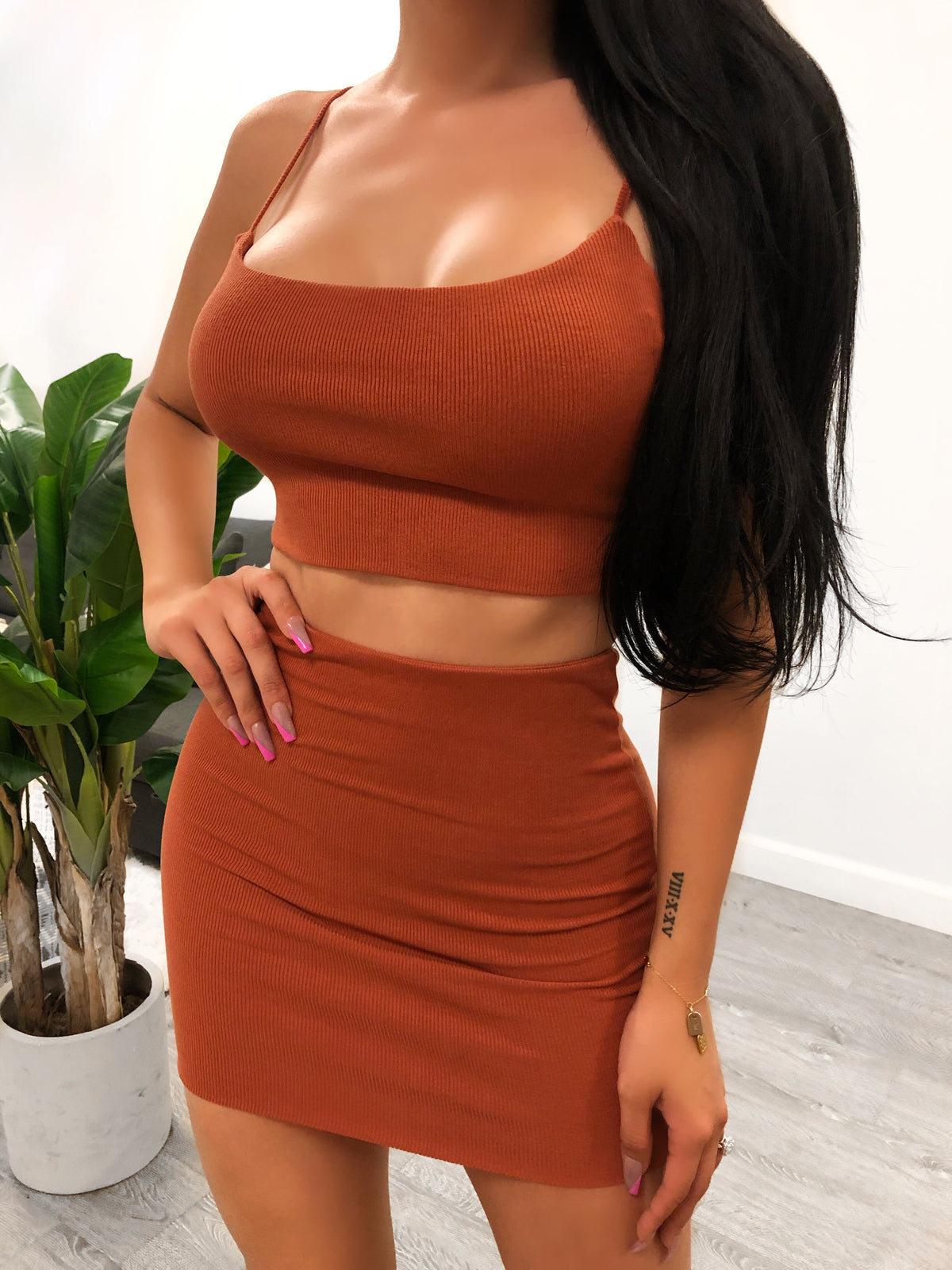 rust 2 piece set. crop top with adjustable spaghetti straps. skirt is above mid thigh length.