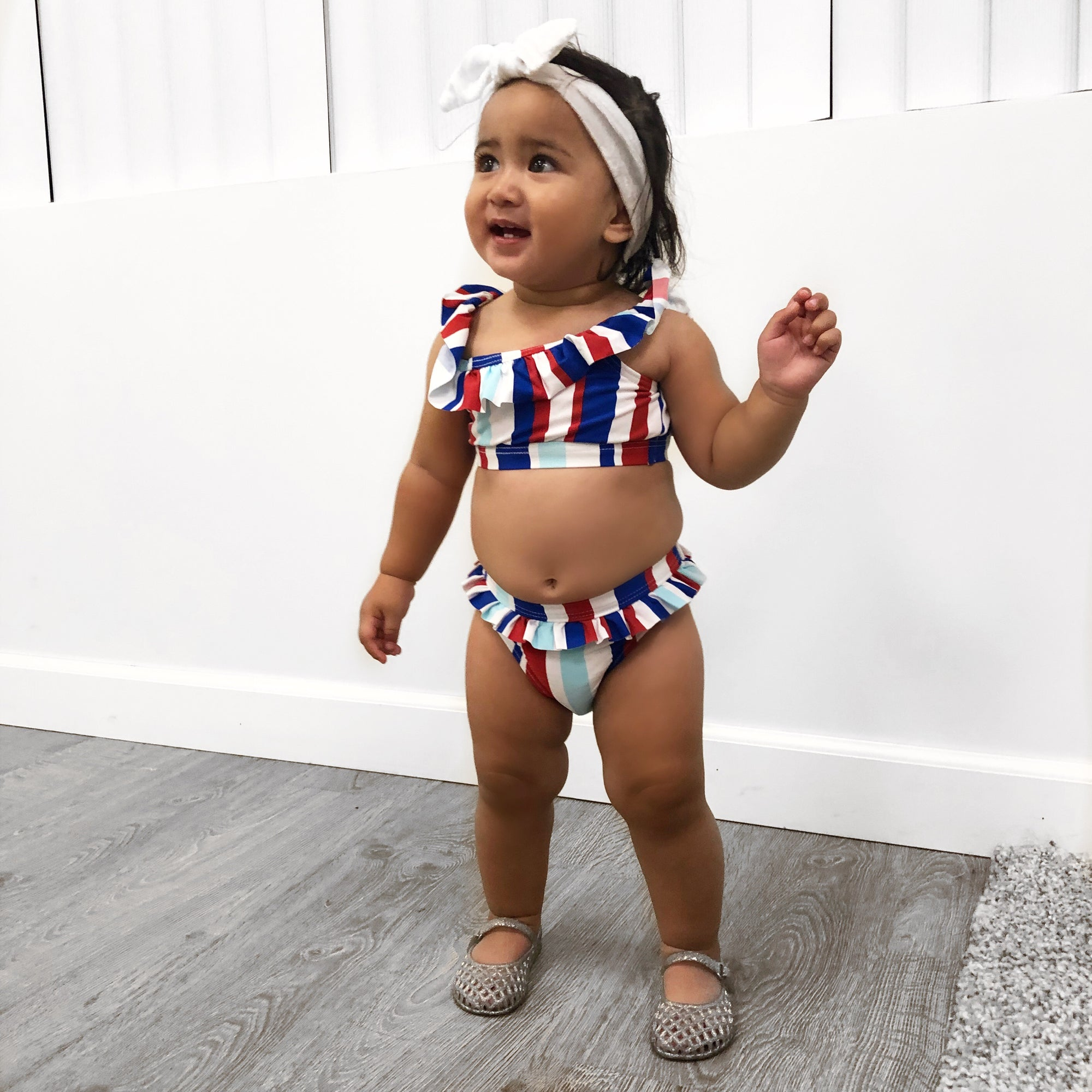 baby 2 piece bikini. Crop tops and bikini bottom. Can be worn off the shoulder. Blue, white and red.