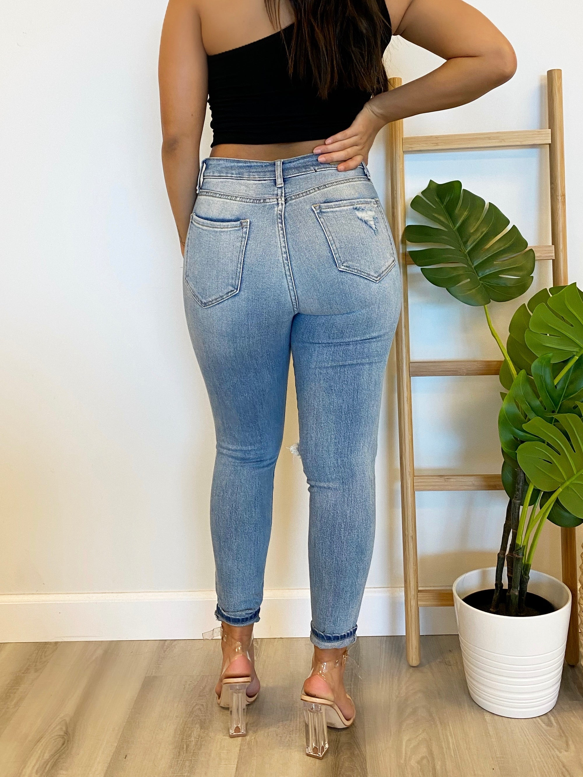 medium wash high waist jeans, distressed at both knees, 2 front pockets, zipper