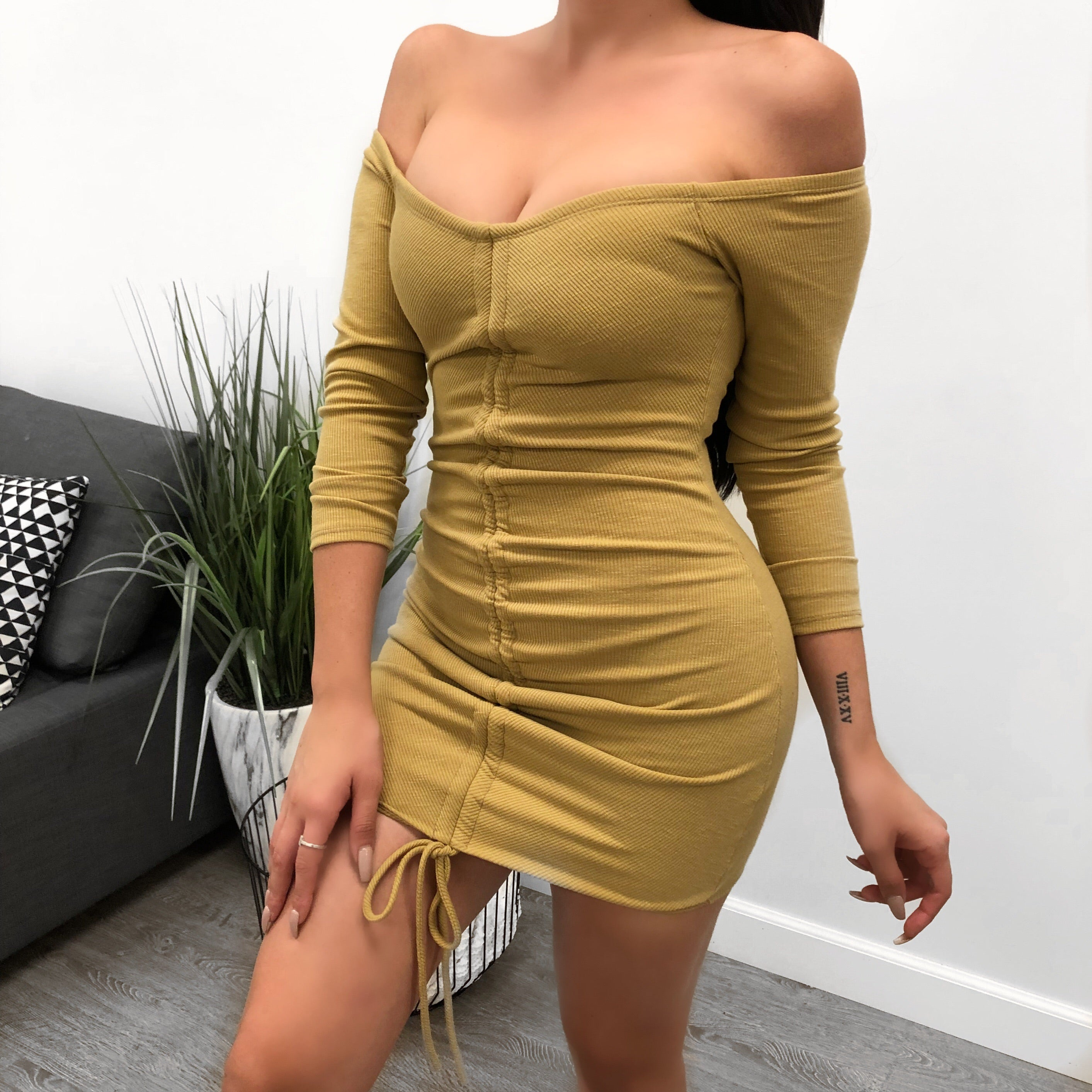 mustard long sleeve dress. off the shoulder. adjustable strings down the middle for preferred fit. above mid thigh length.
