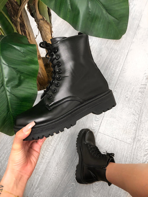 black combat boots, up to ankle, leather boots