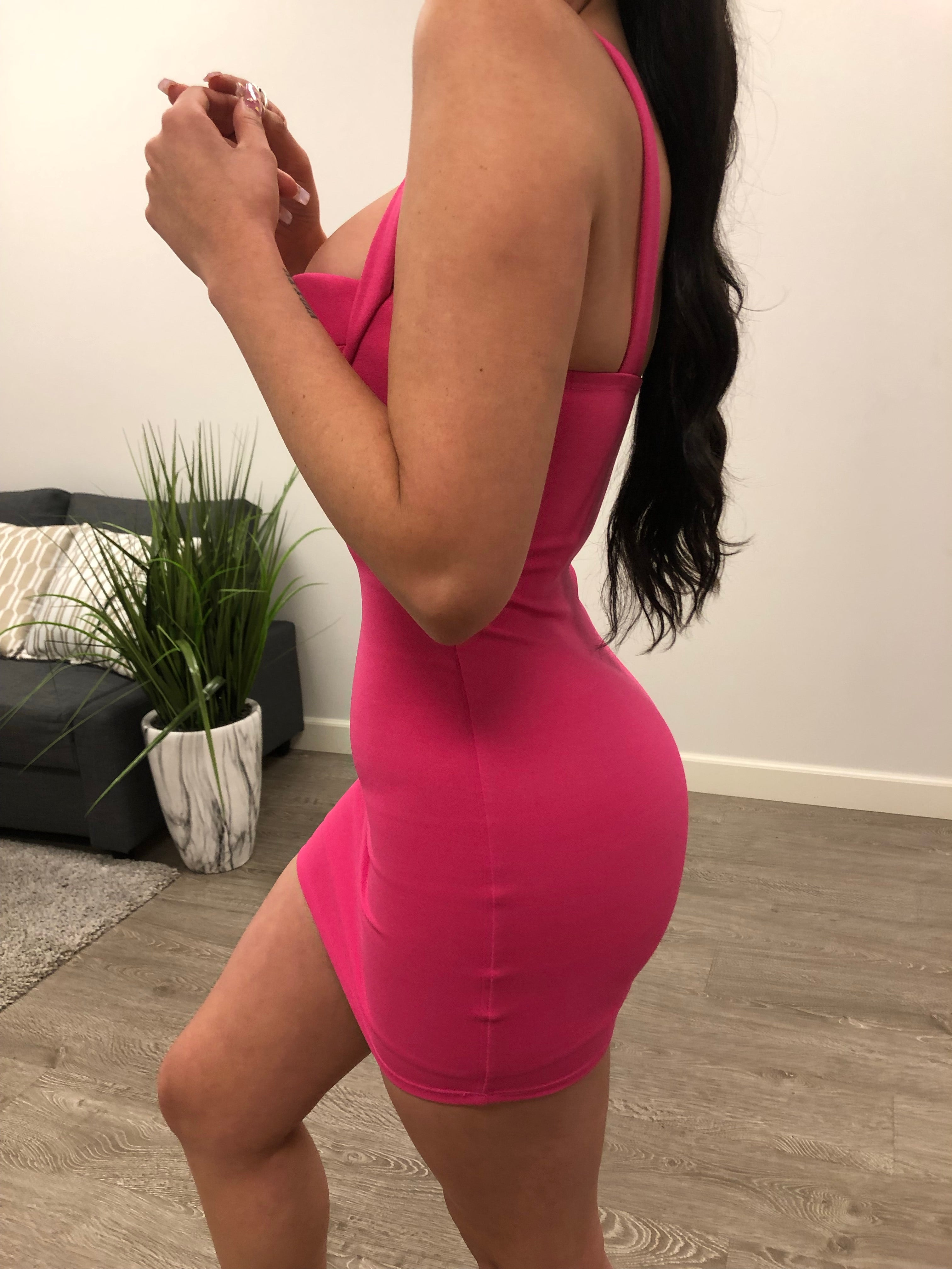 hot pink short dress. straps are not adjustable. sweet heart neckline. shows cleavage. above mid thigh length.